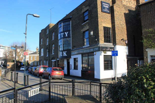 Cutty Sark Pub. You can enjoy a beer outside overlooking the river.