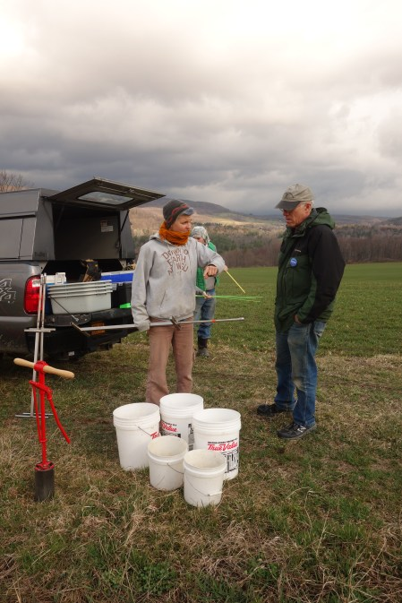 Sandra Wayman and Brian Caldwell prepare for soil sampling at a farmer's field