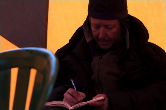 Team member Vladimir Mikhalenko of the Russian Academy of Sciences, a veteran of many such expeditions, logs his notes for the day.