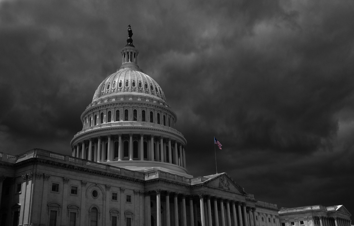 Black and white image of clouds over U.S. Capitol building