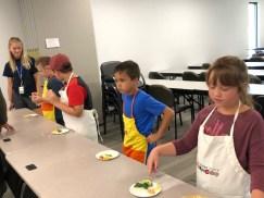Children making their snacks.