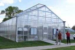 Belinda and Will observing the outside view of the 30' x 55' greenhouse at Lincoln Intermediate