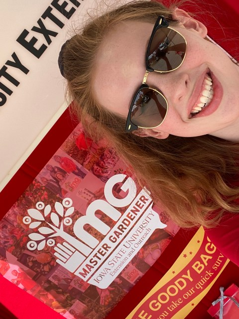 Kaylee taking a selfie with the fair booth