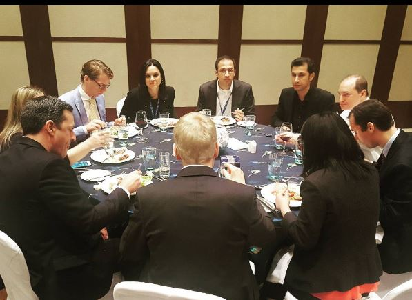 round table discussion at dinner, during a day in the life of a Global Executive MBA student