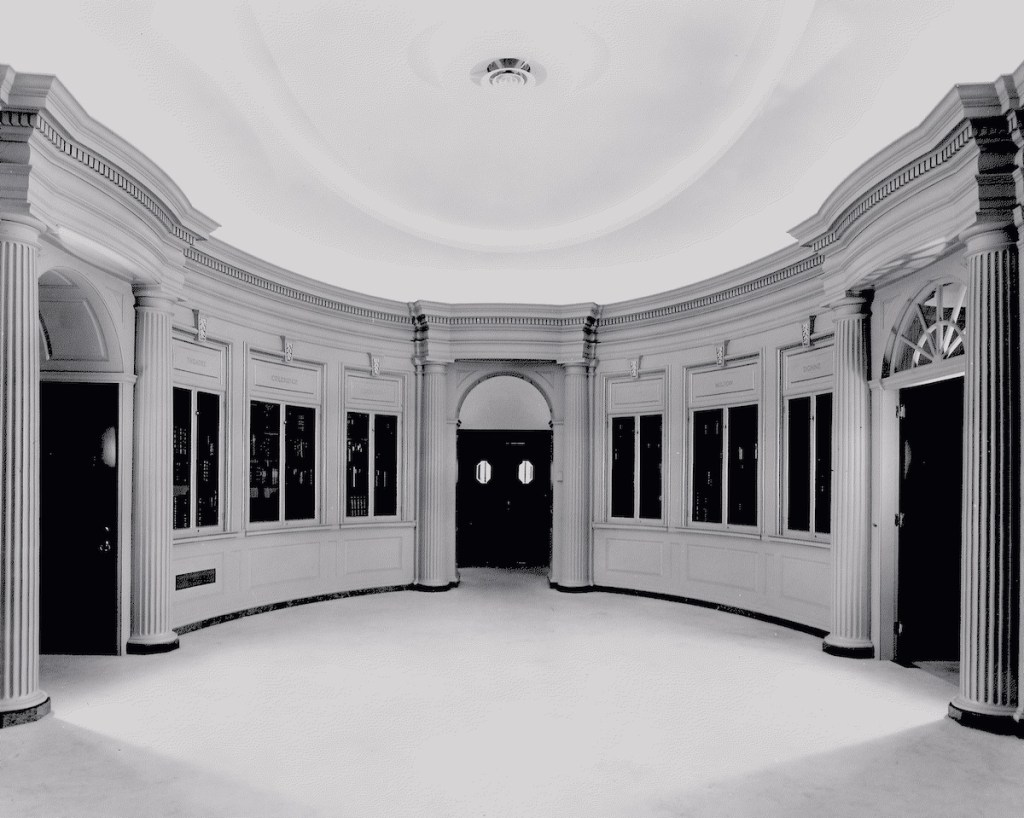 An image of the Houghton Library lobby, ca. 1952, with a view of the reading room doors and tray ceiling.