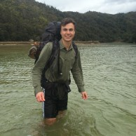 Wading through frigid water to cross and estuary