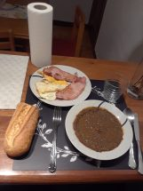 Lentejas, jam, eggs, and bread