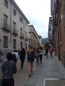 Walking past San Lorenzo's colorful buildings on our way to El Escorial monastery.