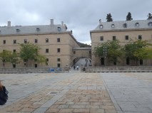 A view of El Escorial's surrounding buildings that complement its austere character.