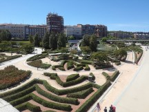 A snapshot of some artful gardens taken from a bridge over the Manzanares river.