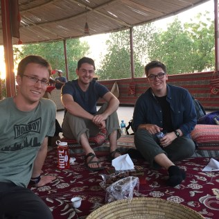 Hope students (left to right: David, Ben and Danny) having water, dates, and oranges
