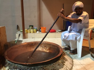 Man making Halwa at Muscat Festival