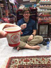 Danny having a cup of Karak in Shah's shop