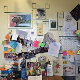 By the end of the year the wall was just a bit more full with pictures, notes, and signs from friends.