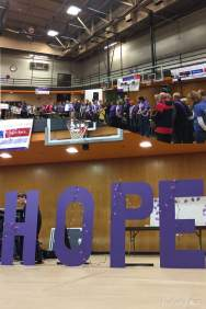 The survivors and caregivers that came to Hope's Relay event. and Large Purple letters spelling out Hope