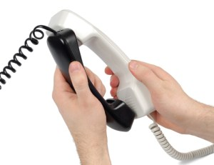 audioconference-telephone-handsets-kissing