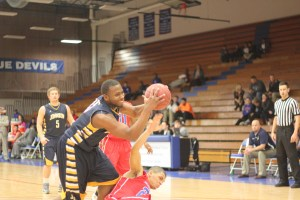 Donnell Bronson struggles for a rebound on the road against Kansas City Kansas Community College. The Cavs would lose the game 67-49