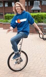 Miles Johnson takes his unicycle for a spin. He's been riding since sixth grade.  Photo by Anya Ivantseva