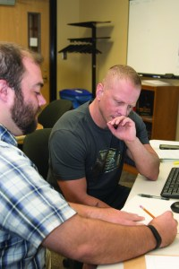 Taking advantage of the tutoring the Veteran's and Military Student Resource Center, student and veteran Donny Whitton (right) and Math Resource Center tutor Thomas Parra (left) tackle Whitton's MyMathLab assignment.