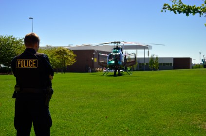Campus officer keeps landing area clear and safe. Photo by E.J. Wood.