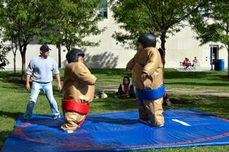 Two young fest-goers enjoy sumo wrestling. Photo by E.J. Wood.