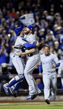 Kansas City Royals catcher Drew Butera and relief pitcher Wade Davis celebrate after winning the World Series on Sunday, November 1, 2015 at Citi Field in New York. Photo courtesy of Shane Keyser, Kansas City Star, skeyser@kcstar.com