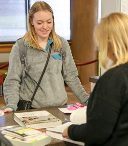 Palmer Meeds (student) returns her books at the buyback lounge located on the first floor of the Commons building. Both buybacks and rental return services are available at this location.