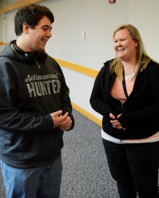 Students Christian Kenkel, left, and Rachel McCullough, right, laugh after discussing whether or not they would choose to win the lottery and never have to work a day in their life or have a dream job that is fulfilling and exciting. Photo by Andrew Hartnett.