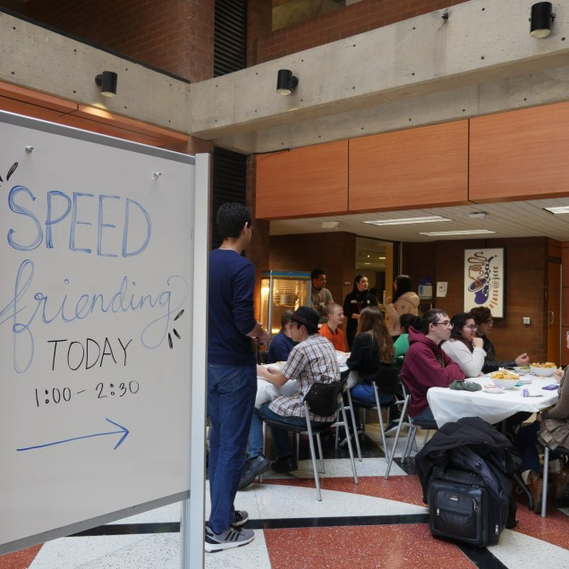 Student ambassadors set out tables, so students could meet new friends over chips and salsa in COM. Photo by Kaytlin Hill, The Campus Ledger.