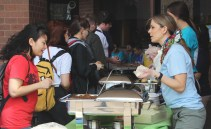 """The International Club was out in the COM courtyard serving food and bring awareness to international Day, on Wednesday. """"This is to help to realize the diversity that the college has... This day allows us to express ourselves..."""" - Matthew Ghilino. Photo by: Jennifer Tharp, The Campus Ledger."""