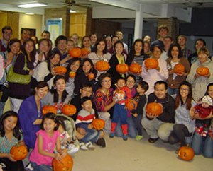 Student families at Texas A&M University show the pumpkins they carved during a 2012 fall harvest party at University Lutheran Chapel. The mix of students there is indicative of the growing number of Asian students at U.S. institutions of higher learning. (Paul Hoemann)