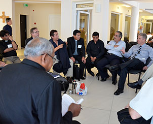 Lutheran church leaders and seminary representatives from Central and South America gather during a portion of the World Seminary Conference when its participants met according to regions to discuss challenges and opportunities facing Lutheran seminary education. (LCMS Communications/Amanda Booth)