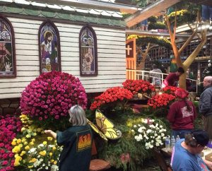 """""""Petal Pusher"""" volunteers work on the Lutheran Hour Ministries (LHM) float prior to the 2014 Rose Parade. The LHM float — the only one with a Christian theme among more than 40 entries — received the Princess Award trophy. (Matthew C. Harrison)"""