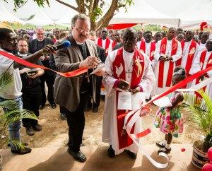 LCMS President Rev. Dr. Matthew C. Harrison cuts the ribbon as he and Evangelical Lutheran Church of Ghana Bishop Rev. Dr. Paul Kofi Fynn open the Ghana church's new seminary building Feb. 2, as part of daylong dedication festivities. (LCMS Communications/Erik M. Lunsford)