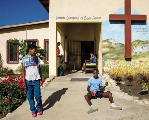 Residents of the Good Shepherd Lutheran Group Home in Palmar Arriba enjoy the warm afternoon sun. The home provides care for children with mental and physical disabilities and was founded and is served by members of the LCMS mission team in the Dominican Republic and members of the local Lutheran congregation. (LCMS Communications/Pamela Nielsen)