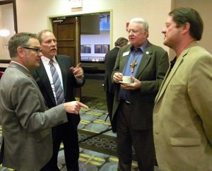 Ross Stroh, far left, the Synod's new executive director of Accounting, meets LCMS Board of Directors members Jim Carter and Ed Everts, third and fourth from left, during a break in the Board's Feb. 14 meeting. To Stroh's left is Synod Chief Administrative Officer Ron Schultz. In the background is LCMS Secretary Rev. Dr. Raymond Hartwig. (LCMS Communications/Joe Isenhower Jr.)