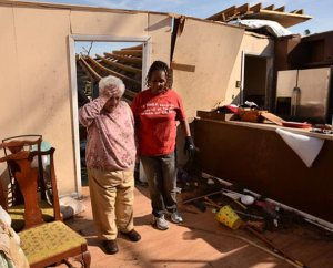 Connie Lambert, left, walks through her tornado-damaged home in Tupelo, Miss., on May 2. The EF3 tornado damaged more than 2,000 homes and 100 businesses. (LCMS Communications/Erik M. Lunsford)