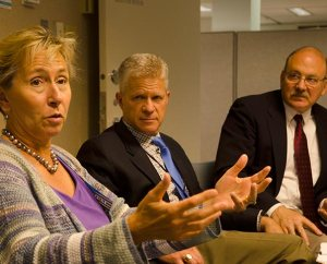 Dr. Mary Scott, left, provost and executive vice-president at Concordia University, Irvine, Calif., makes a point during the May 29 conference in St. Louis. Listening are the Rev. Randall L. Golter, center, executive director of the LCMS Office of International Mission, and the Rev. Dr. John Mehl, director of mission partnerships and church relations at Concordia University, Nebraska, Seward. (LCMS Communications/Frank Kohn)