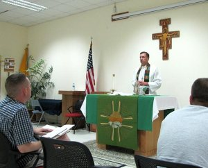 "Chaplain Jim Buckman leads a Protestant Liturgical Worship Service at Al Udeid Air Base in Qatar. The service used Lutheran Service Book and employed the full-organ accompaniment for Divine Service, Setting One, from ""The Concordia Organist"" CD set, which was played each week on a laptop computer."