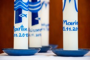 Baptism candles bear the Christian names of Muslim converts.