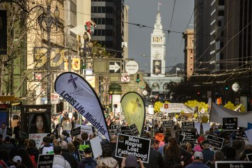 Lutherans carry the banners near the end of the 2016 Walk for Life West Coast. In the distance is the iconic Ferry Building. (LCMS/Erik M. Lunsford).