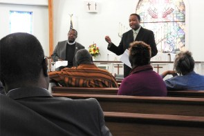 The Rev. Dr. Roosevelt Gray Jr. (right), director of LCMS Black Ministry, addresses the caucus during its recent meeting at Trinity Lutheran Church, Mobile, Ala. At left, also facing the camera, is the Rev. Samuel Cosby, a member of the Synod's Board for National Mission. (LCMS/Paula Schlueter Ross)