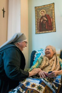 Sister Constance Veit of Little Sisters of the Poor shares a laugh with Eva Howse March 21 in Washington, D.C. The Little Sisters of the Poor filed a complaint against the Affordable Care Act's contraceptive mandate in 2013. (Courtesy of USA Today/Jarrad Henderson)