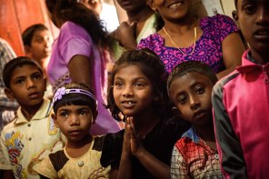 Children are among those gathered at the Kandapola preaching station to hear the psalms and pray.