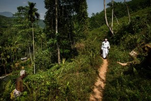 The Rev. Roger James, LCMS area director and missionary to Sri Lanka, walks a jungle trail to visit the Eila Rubber Plantation for Palm Sunday.