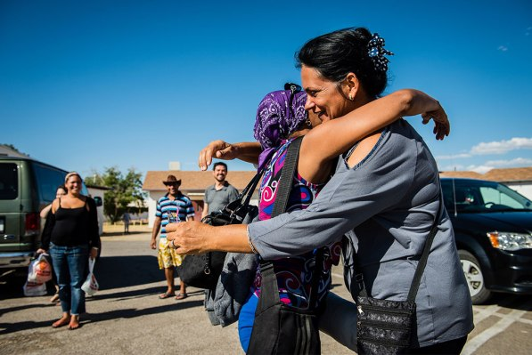 Hildelisa Rodriguez Mesa, right, greets a fellow Cuban immigrant May 20 at Ysleta Lutheran Mission Human Care in El Paso, Texas. Both migrants journeyed together through South and Central America as they struggled to reach the United States.
