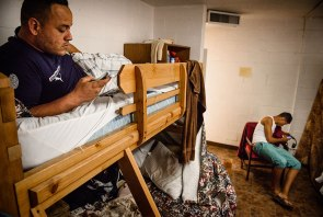 Andy Borrero, a new Cuban immigrant to the United States, relaxes May 21 at Ysleta Lutheran Mission Human Care in El Paso, Texas.