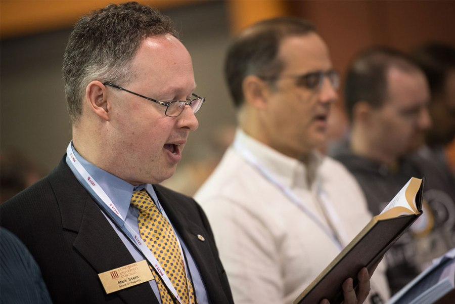 Mark Stern, a voting lay delegate from the LCMS Northern Illinois District, sings Hymn 283 from his own copy of The Lutheran Hymnal at the LCMS convention July 14 in Milwaukee. (LCMS/Michael Schuermann)