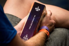 A participant holds an LCMS Youth Gathering Lutheran Study Bible from Concordia Publishing House during a Witness, Mercy, Life Together Bible Study Academy led by LCMS President Rev. Dr. Matthew C. Harrison. (LCMS/Erik M. Lunsford)