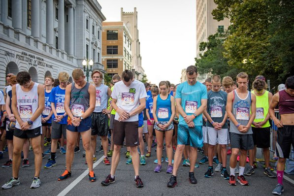 Race participants in the early morning Gathering 5K pray before its start. (LCMS/Erik M. Lunsford)